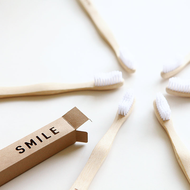 Smile toothbrush wrap for guest tray